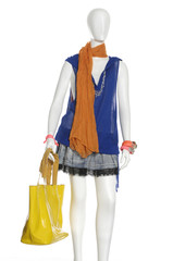 female clothing in orange with scarf with bag