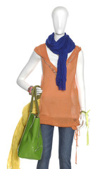 female clothing in jeans with scarf, bag on mannequin