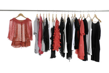 Colorful collection of women's clothes hanging