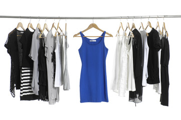 A row of summer clothes hanging on the rack