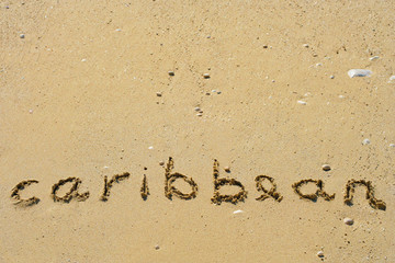 Conceptual handwritten text Caribbean in sand