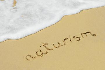 Naturism handwritten in sand