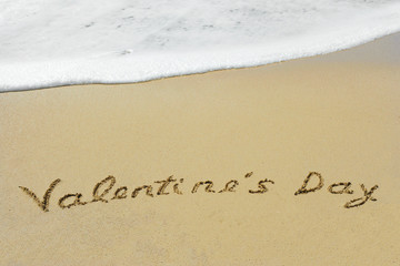 Conceptual handwritten text Valentine`s Day in sand