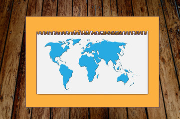 Paper world map on wood background