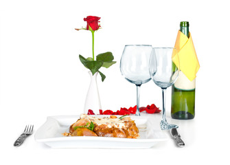 t table with meat with vegetables and glass for wine and bottle