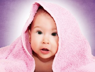 Baby and pink towel