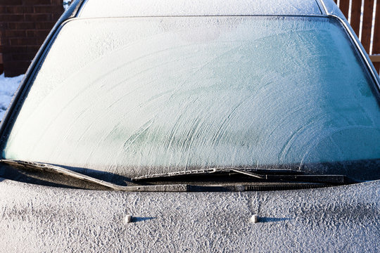 Frost on a completely covered car windscreen