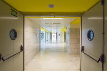 clean and long corridor whith fire doors
