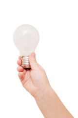 Kids hand holding light bulb. Idea concept.