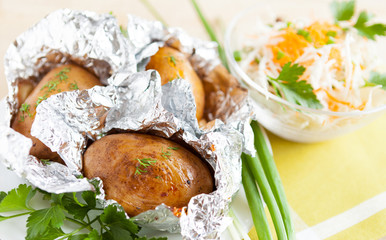 Jacket potatoes baked in foil, and greens