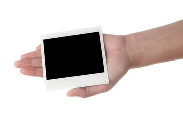 hand holding photo frame