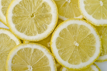 Tuinposter Plakjes fruit Food background - Sliced mugs lemon
