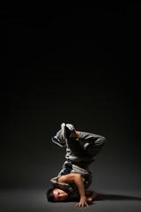 breakdancer posing over dark