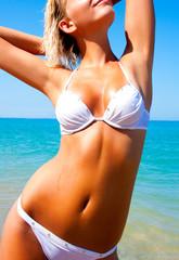Beautiful Girl Relaxing on the Beach