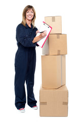 Happy delivery woman preparing an invoice