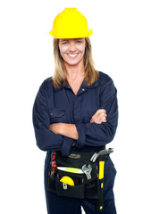 Attractive architect woman with yellow hard hat