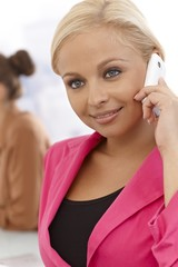 Closeup portrait of businesswoman on cellphone