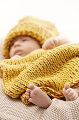 Newborn baby with bare feet