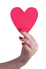Female hand with red manicure holding a paper heart