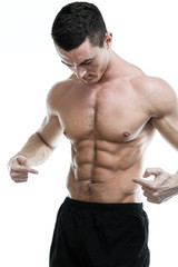 Handsome muscular man, showing his abdominal muscles.