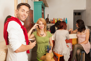 young attractive people in colorful cafe