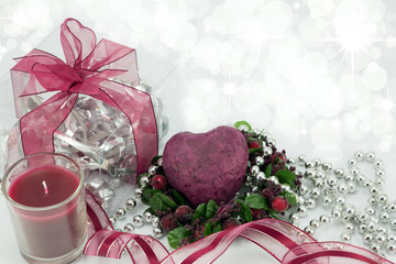 Deep red heart with gift,candle and ribbon.
