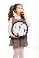 little girl shows that it is time to start eating healthy