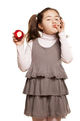 pretty little girl in a dress showing palatability of apple