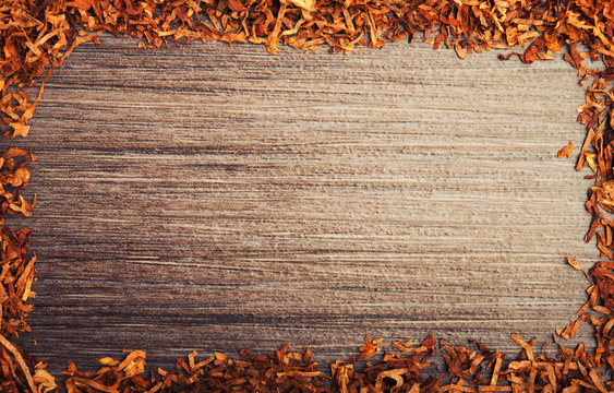 Framed with tobacco on wooden background