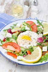 Vegetable salad with poached egg, vertical