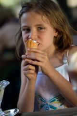 Cute little girl eating an icecream