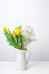 tulips in a white jug