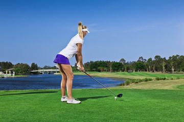 Young golfer girl