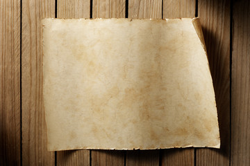 old blank paper sheet on aged wood