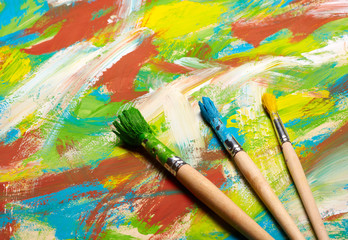 Paintbrushes on abstract grange background