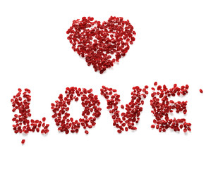 Love made from red rose petals on white background