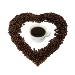 Cup of coffee and coffee beans in the form of heart