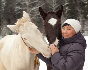 Asian girl and two horses