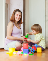 pregnant mother plays with child
