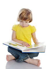 little girl reading a book. isolated