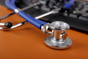 Stethoscope and keyboard illustrating concept of digital securit
