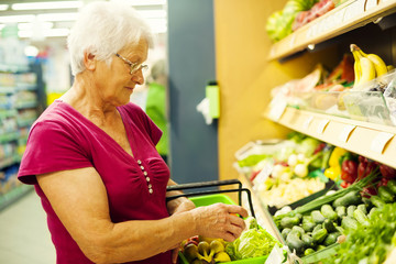 Senior woman at supermarket.