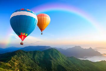 Poster Ballon Colorful hot-air balloons flying over the mountain