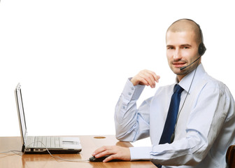 Businessman with headset sitting at office desk