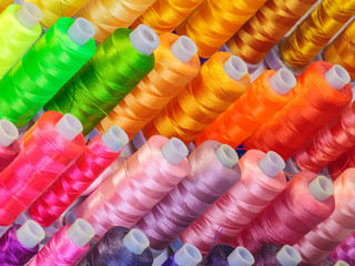 Reels with colorful sowing threads