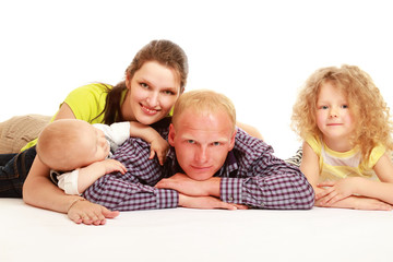 Peaceful family lying in circle on the wall-to