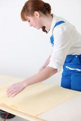 Woman preparing new wallpaper