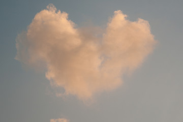 Heart in the sky. Real texturized clouds