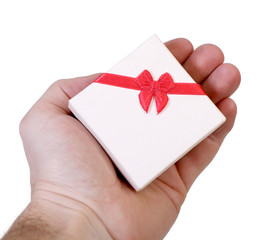 Gift box in a male hand isolated on white