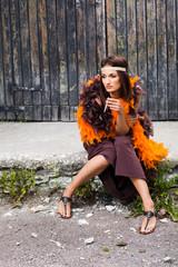 smoking actress in brown and orange boa